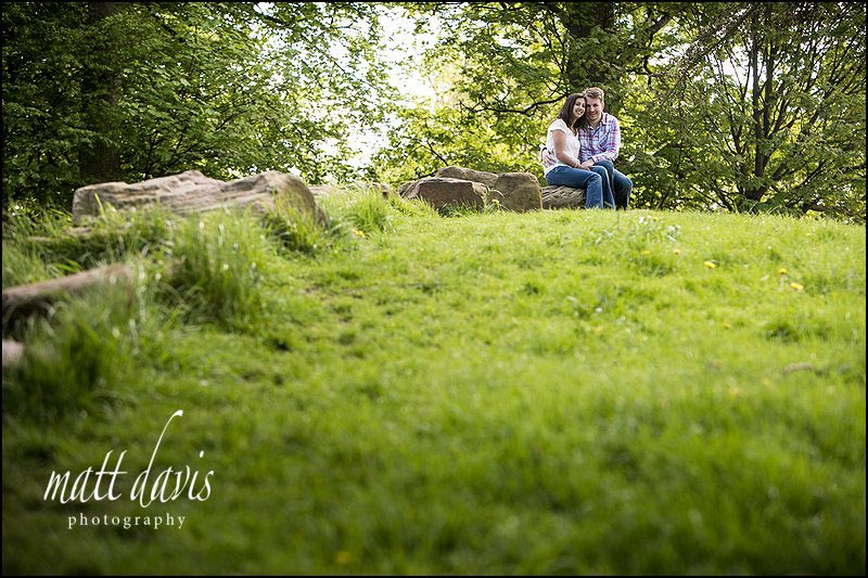 Couple posing for portrait photography in Pittville Park, Cheltenham