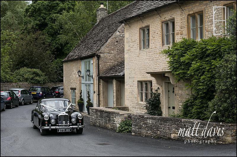 Wedding car arriving at St Mary's Church in Bibury