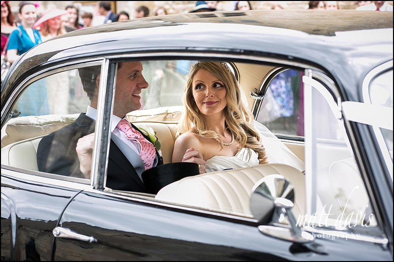 Gloucestershire wedding photographer Matt Davis takes stunning wedding photo of bride and groom in wedding car