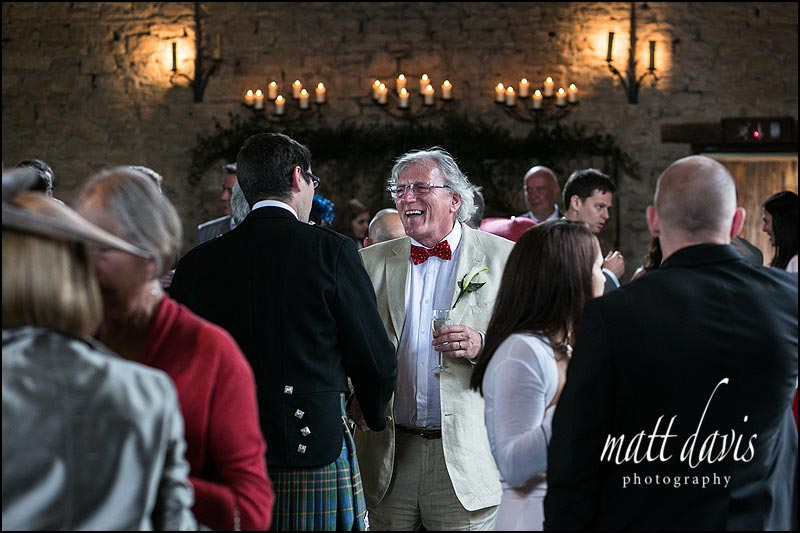 Wedding guests at Cripps Barn, Gloucestershire