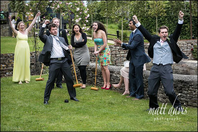 wedding guests playing croquet at Cripps Barn wedding photography by Matt Davis
