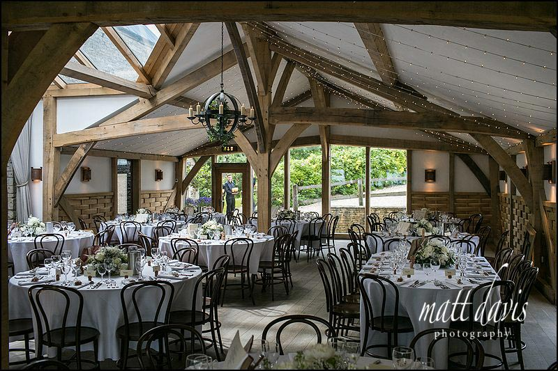 inside Cripps Barn oak beam wedding reception