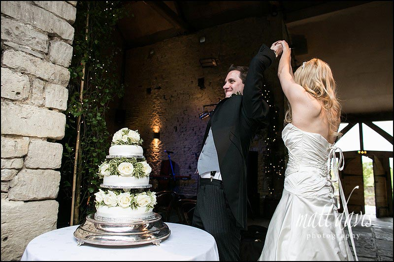 Crazy wedding cake cutting at Cripps Barn, Gloucestershire