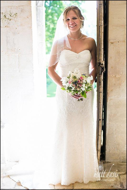 Bride posed in doorway at Rococo Gardens