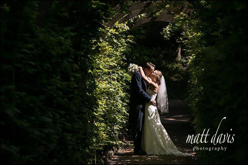 Creative wedding photos in Rococo Gardens, Painswick, Gloucestershire