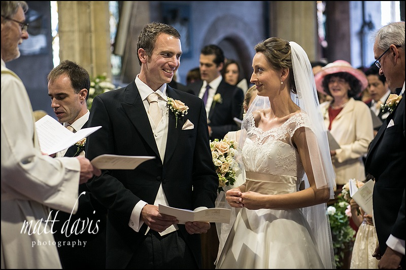 wedding ceremony taking place at St Mary's church, Berkeley