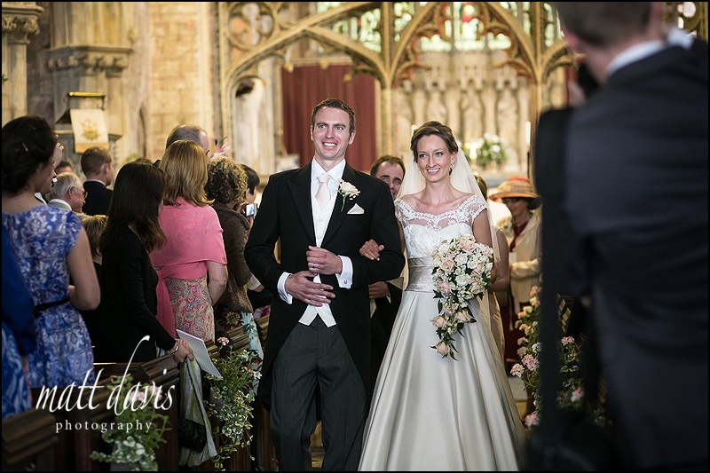Wedding coupe exiting St Mary's Church, Berkeley, Gloucestershire