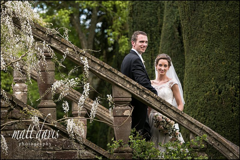 wedding photo taken in the gardens at Berkeley Castle