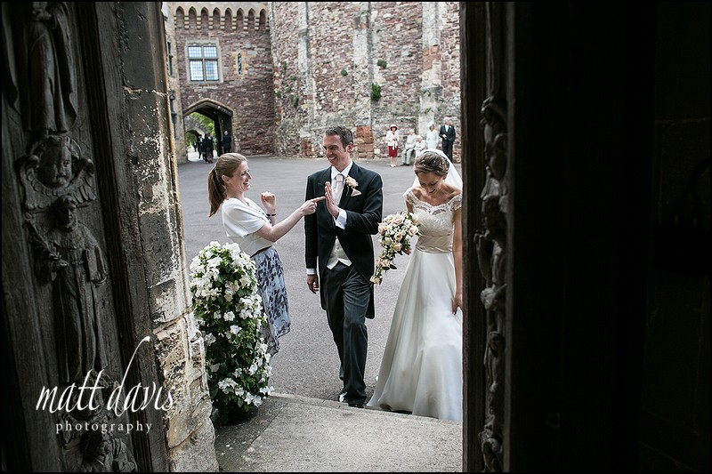wedding couple entering the doorway from the courtyard at Berkeley Castle