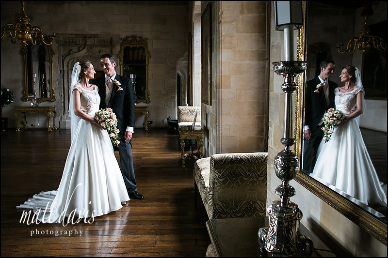 wedding photo at Berkeley Castle taken inside the long drawing room
