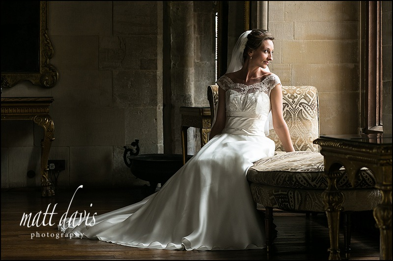 posed wedding photo at Berkeley Castle of the bride in a window seat