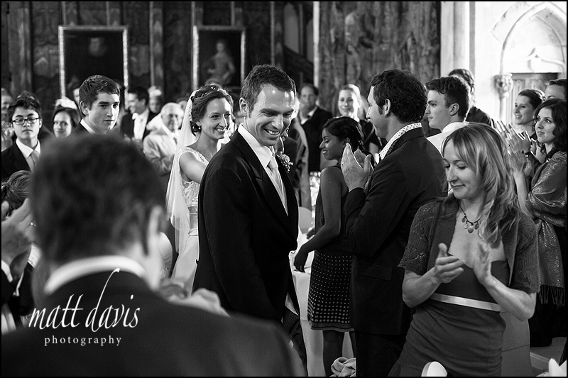 wedding couple entering the wedding breakfast at Berkeley Castle