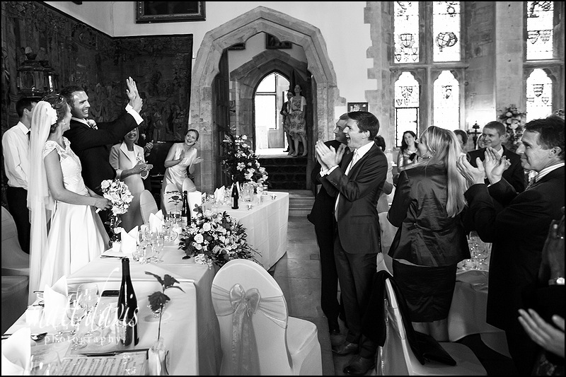 Groom showing of wedding ring to guests at Berkeley Castle wedding