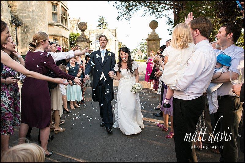 Confetti being thrown at Ellenborough Park wedding