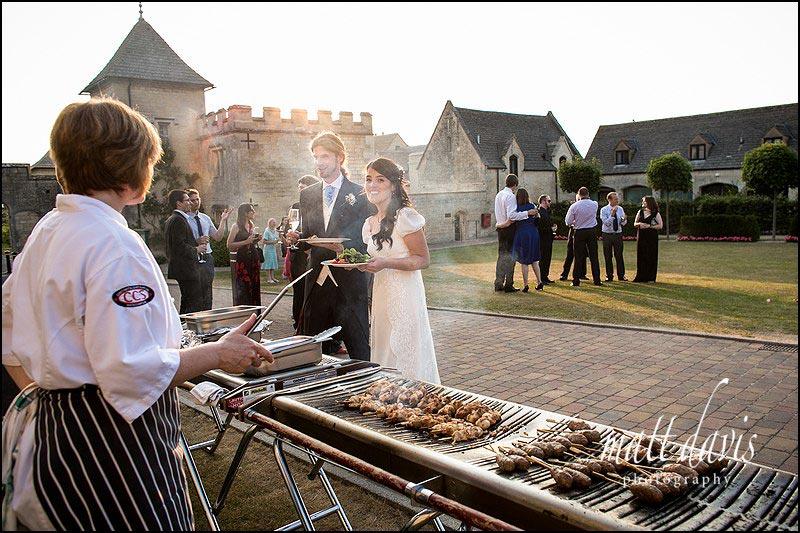 Wedding couple enjoying a BBQ at Ellenborough park on their wedding day