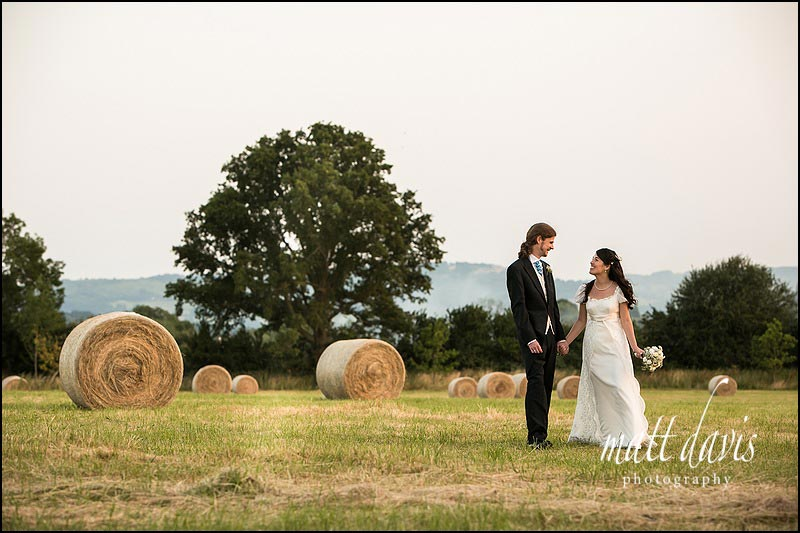 Ellenborough Park wedding photos taken in the field nearby with hay bales