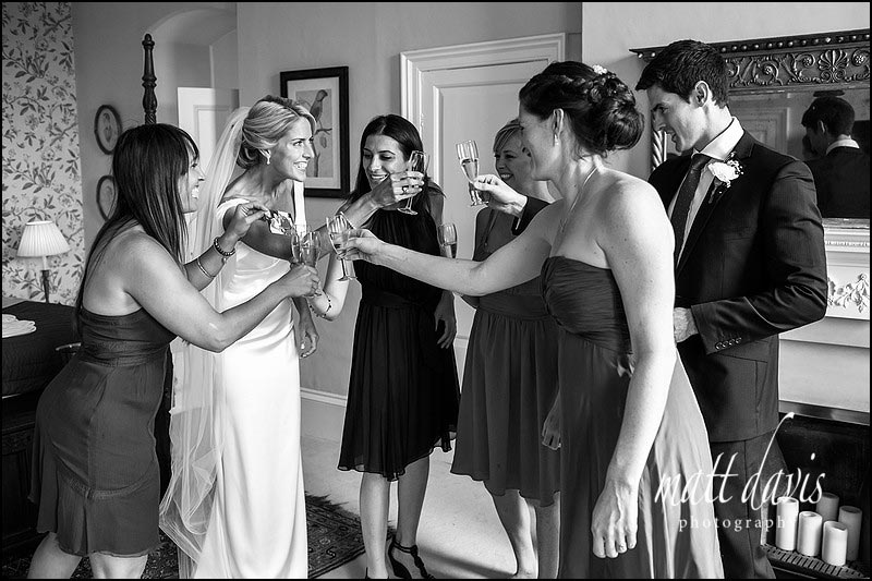 wedding guests toast the bride at Ardington House