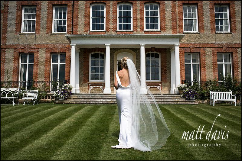 wedding photograph of back of brides dress taken in garden of Ardington House
