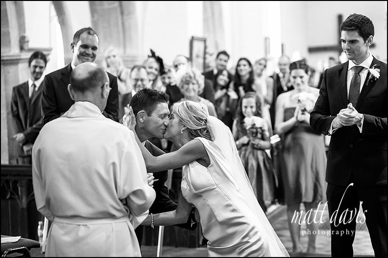 Wedding kiss in St Michael and All Angels church, Steventon, Oxfordshire