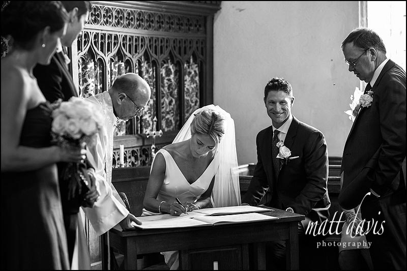 Signing the wedding register in St Michael and All Angels church, Steventon, Oxfordshire
