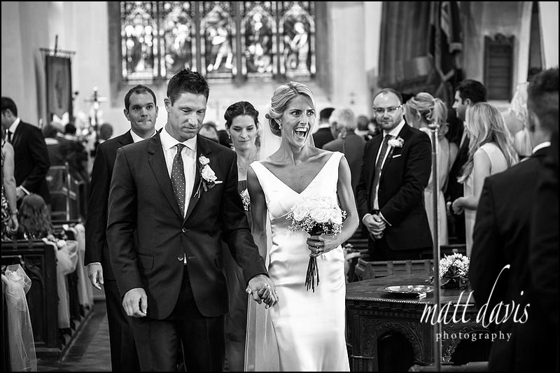 Bride and groom leaving St Michael & All Angels church, Steventon, Oxfordshire