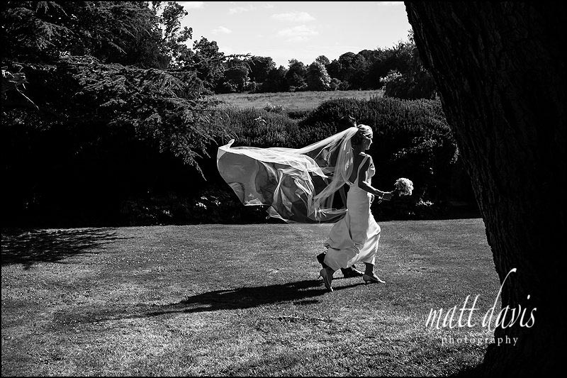 Gorgeous black and white photo of brides veil floating in the wind at a wedding at Ardington House