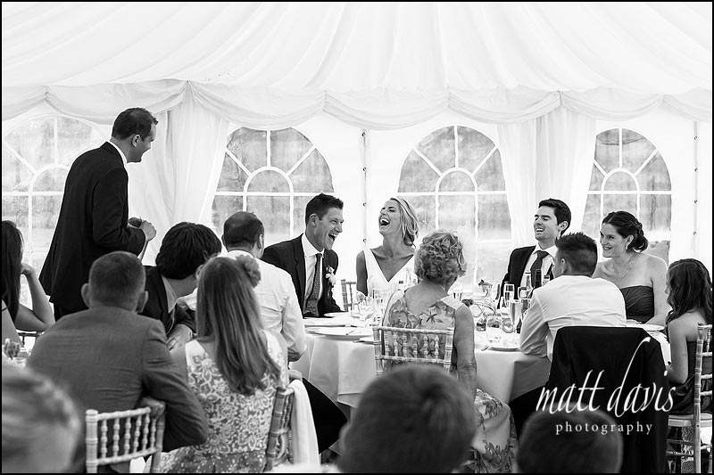 Laughter during wedding speeches at Ardington House, Oxfordshire