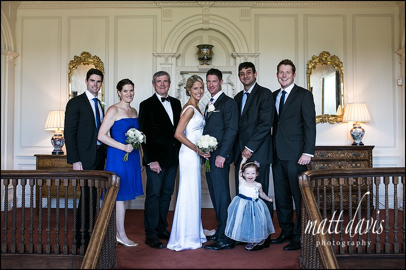 Group wedding photos taken inside Ardington House on the stairs
