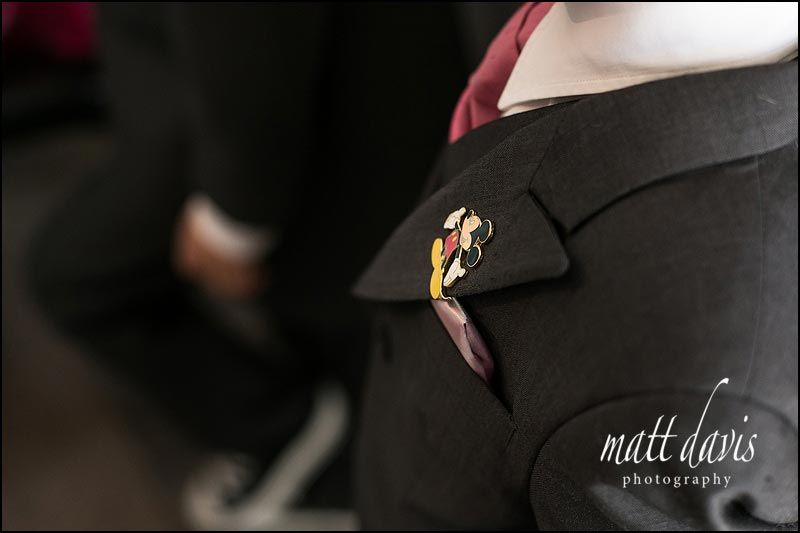 Walt Disney themed wedding with badge pins of Mickey mouse for the paige boys