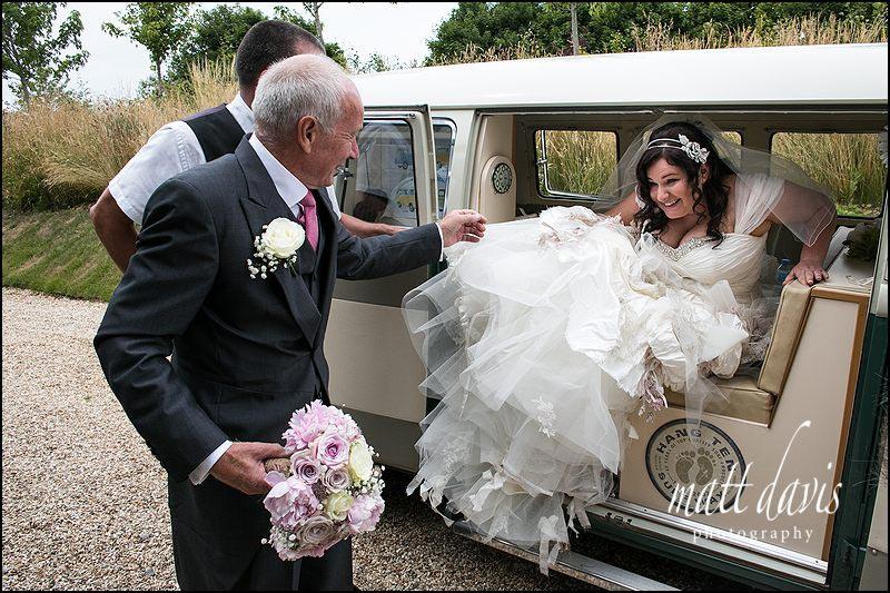 Bride at Cripps Stone Barn in a split screen camper van