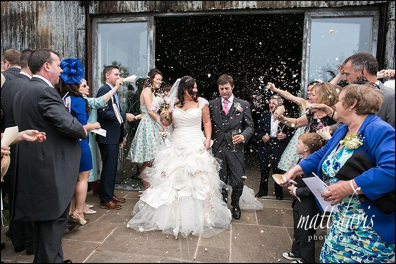 Confetti being thrown at Cripps Stone Barn