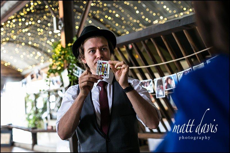 A magician performing at a wedding at Cripps Stone Barn