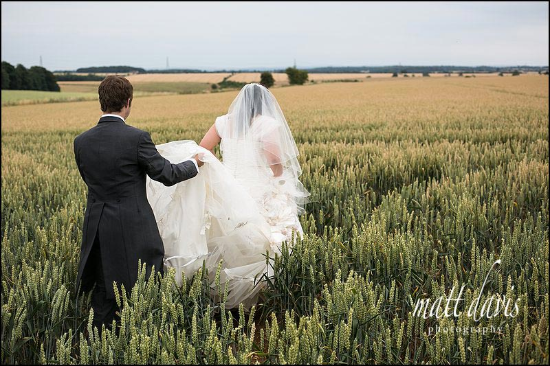 natural wedding photos taken in the field at Cripps Stone Barn, Gloucestershire
