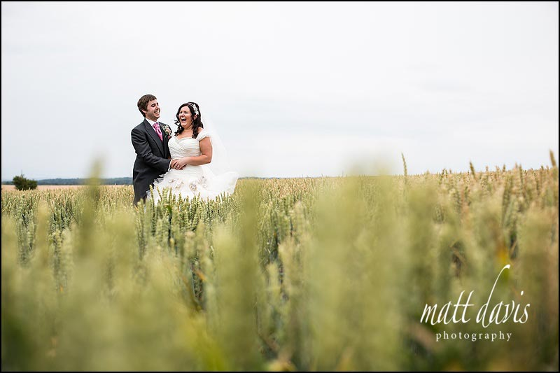Couple wedding photos taken in the field at Cripps stone Barn