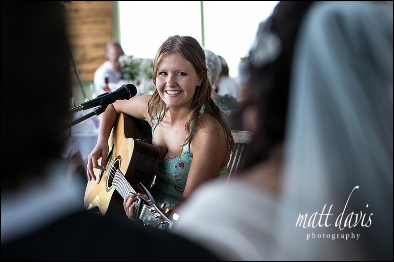 Singer songwriter plays at a wedding at Cripps Stone Barn