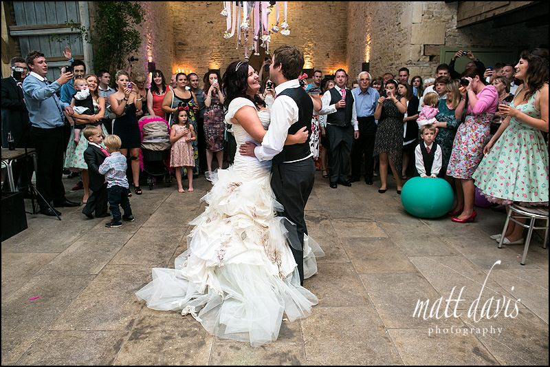 Married couple on the dance floor at a wedding at Cripps Stone Barn