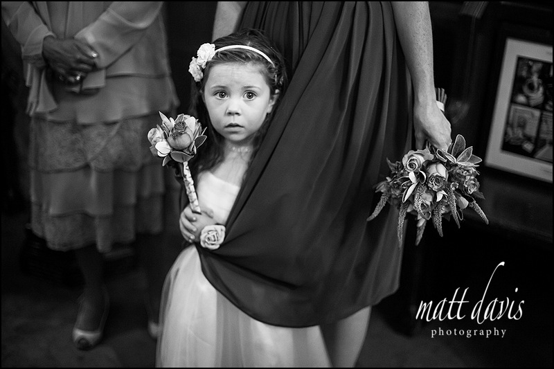 Stunning black and white photograph of flower girl at a Wedding at Kingscote Church