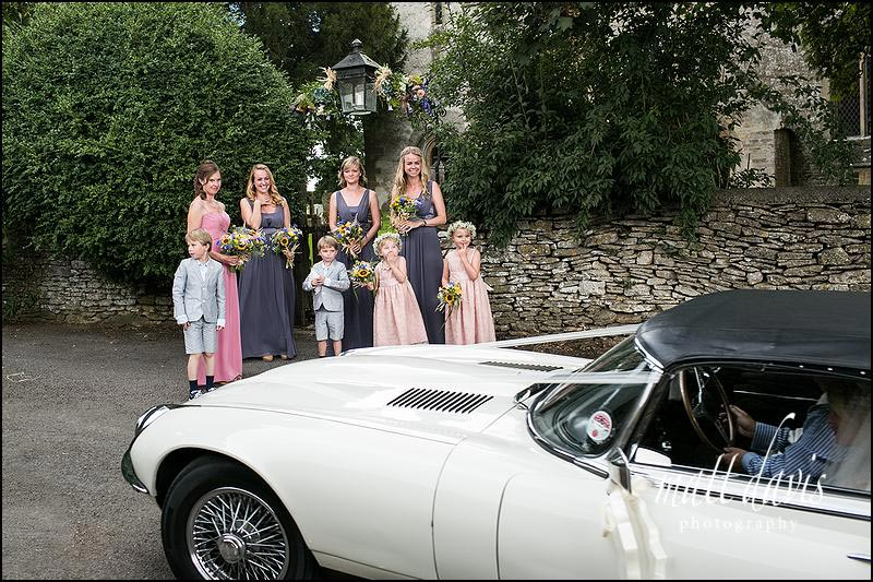 Bridesmaids outside Beverston Church, Gloucestershire