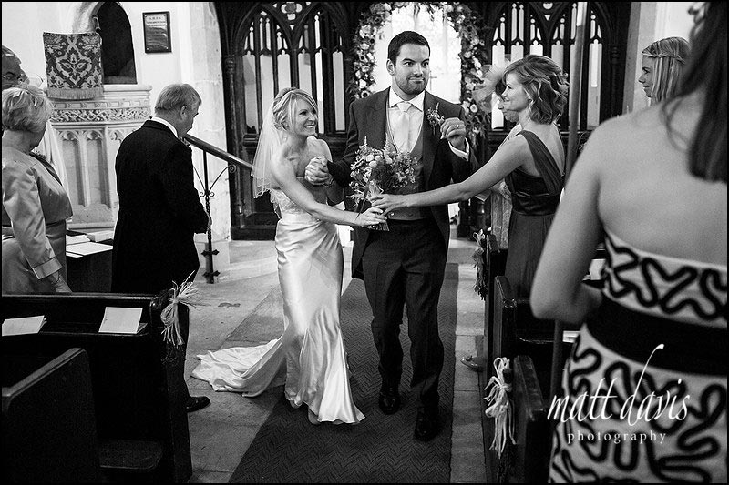 Matt Davis captures the groom dancing down the aisle at a wedding in the Cotswolds