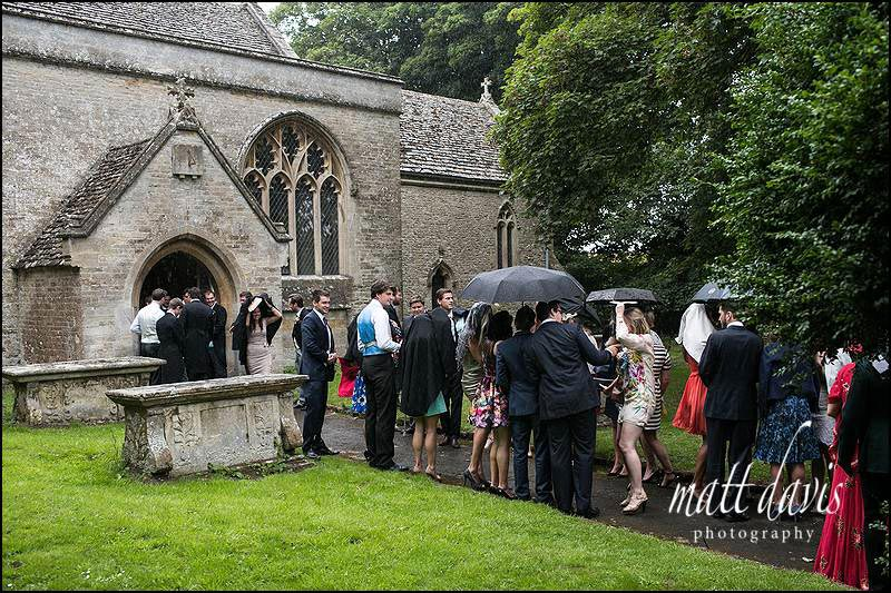 Rain on a wedding day in Gloucestershire at Beverston Church