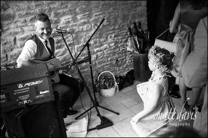 Flower girl dancing to music provided by the Chip Shop Boys at a wedding in the Cotswolds