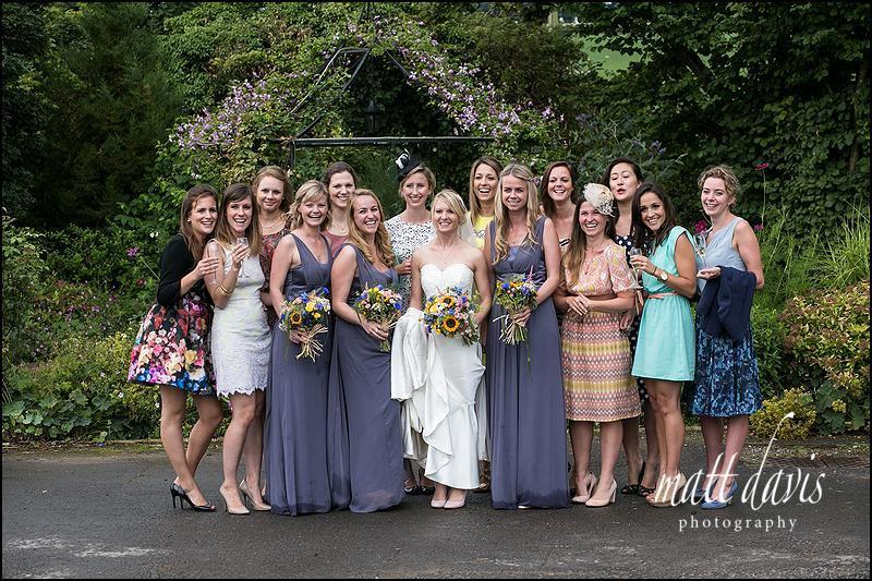 Group wedding photo at Kingscote Barn taken on a wet wedding day