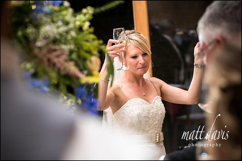 Emotion during Wedding speeches at Kingscote Barn in the Cotswolds