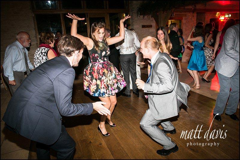 wedding guests dancing on Kingscote Barn dance floor