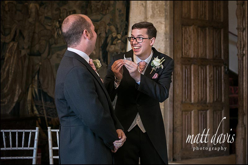 Best man shows the wedding rings to groom