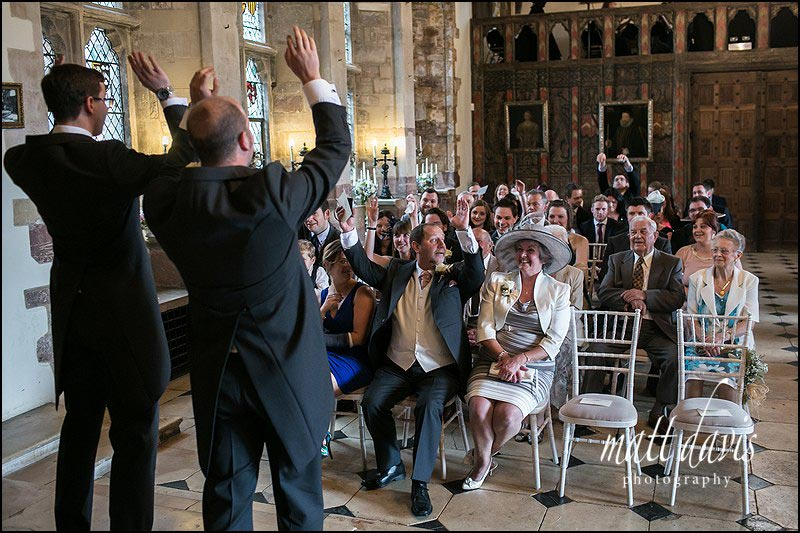 Groom entertains guests during a civil ceremony at Berkeley Castle