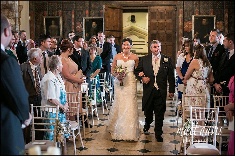Bride walks down the aisle during a civil ceremony at Berkeley Castle