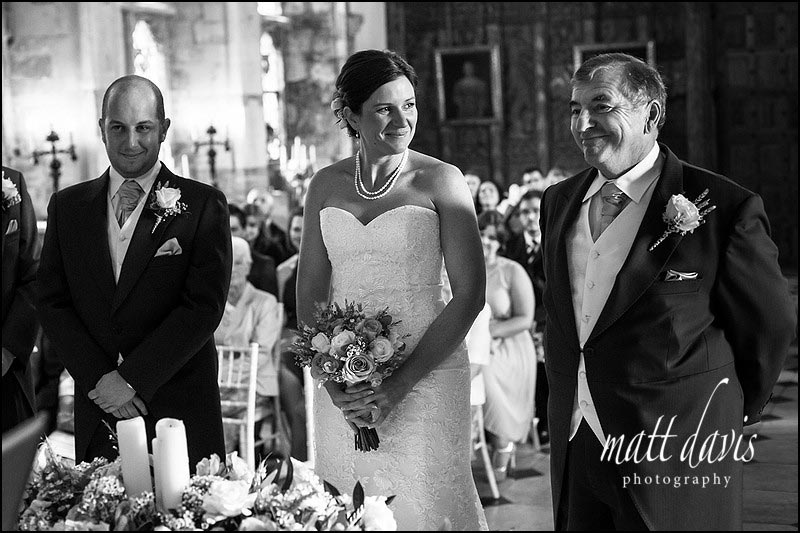 Father of the bride gives away his daughter in the great hall at Berkeley Castle