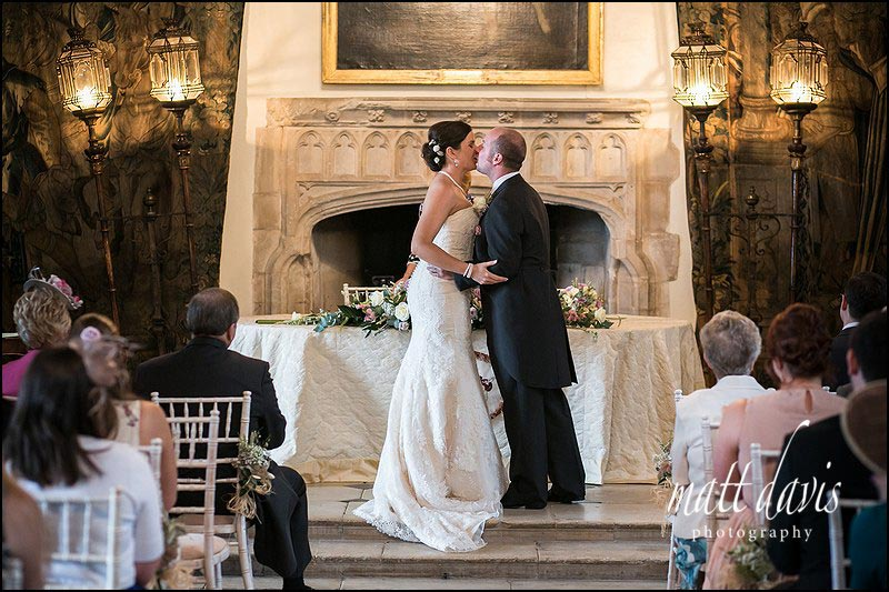 couple kiss during a Wedding at Berkeley Castle