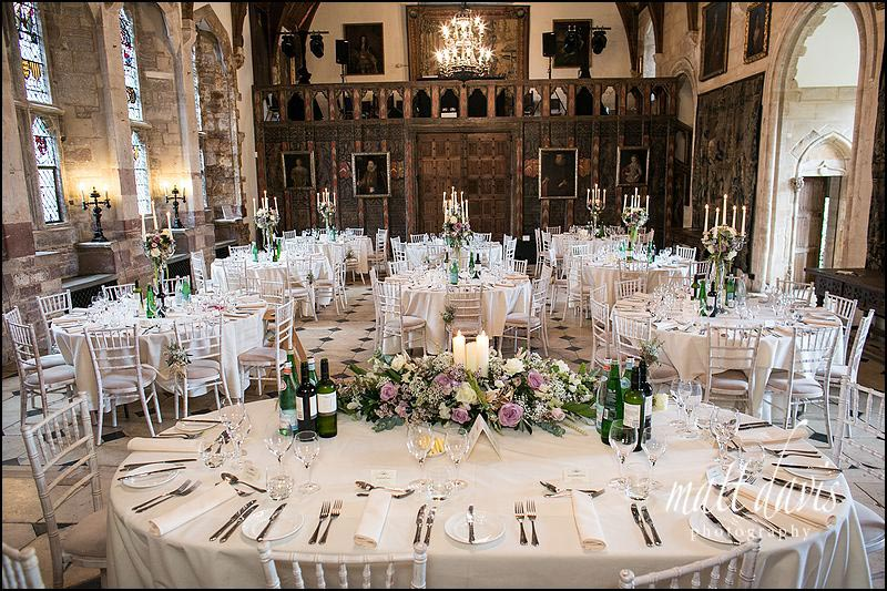 Candle arbors decorate tables in the great hall at Berkeley Castle